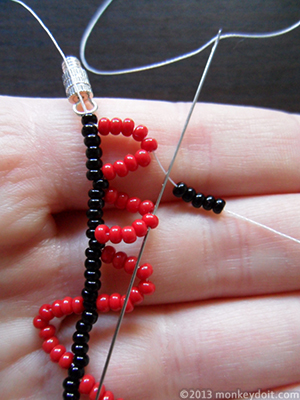 Put 5 beads A onto the needle and push it through the tip of the next chevron.