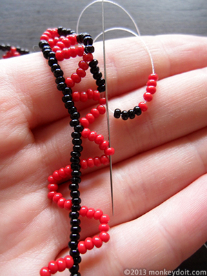 String 4 beads A and 5 beads B and go through the tip of the next chevron