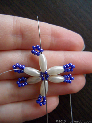 Go up through the next oval bead and one seed bead directly above it