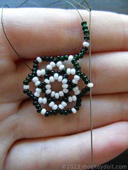 String four beads B, one A and four beads B and slide the needle through bead A from the row below