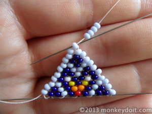 Make a loop with 4 beads