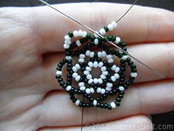 Skip three beads underneath and go through the fourth one