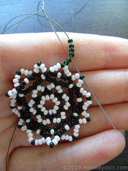 String 6 beads B and push the needle through bead B from the row below