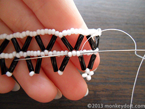 Put 4 beads A and 5 beads B onto the needle and go through the tip of the next chevron