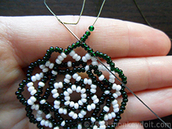 Put four beads onto the needle and push it forward through four beads