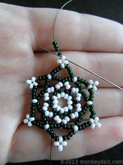 Make a loop by stringing 4 beads B and going back through bead A