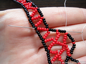 Push the needle up through several beads in any direction