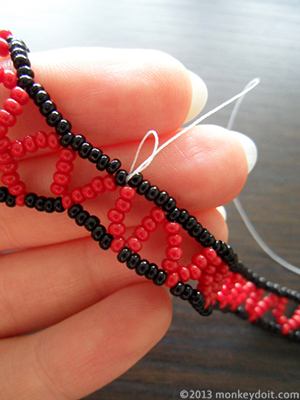 Tie a knot at the base of the closest bead