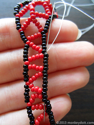Weave the thread through several beads to conceal the knot and cut it