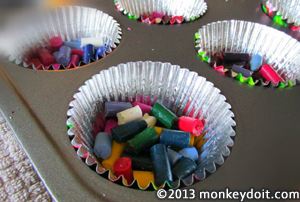 Crayons placed inside baking tray - cup cake pan