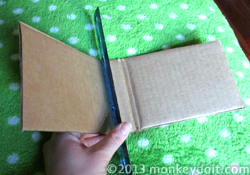 Cut and folded cardboard for notebook or journal