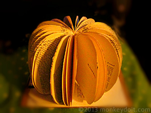 Hot glue securing the pages of the pumpkin book