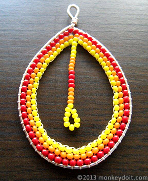 Loop earring decorated with beads on the inside