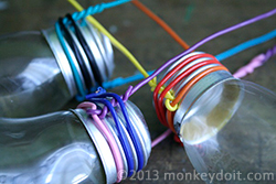 Lightbulb vase with colored wire