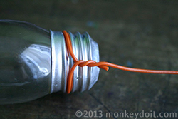 Wrapping and twisting wire around the lightbulb vase