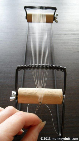 Tie the thread to the loom's dowel nail
