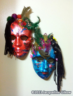 Mask making: Decorative masks adorned with feathers and string.