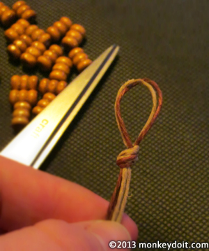 overhand knot at the looped end of the hemp cords