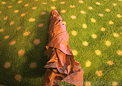 Brown packing paper formed in the shape of a pumpkin stem