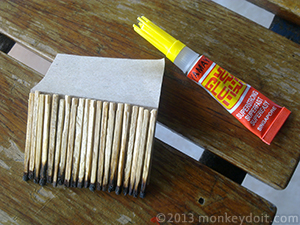 Creating the farmhouse roof with matchsticks